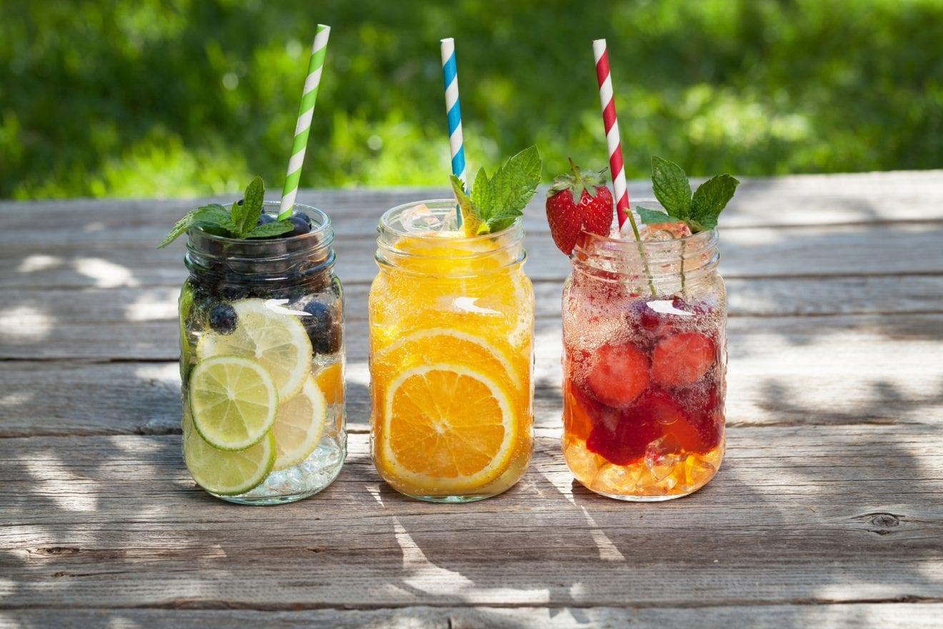 Fresh lemonade jar with summer fruits and berries
