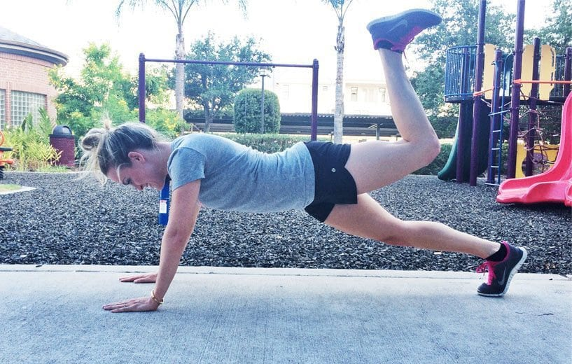 Woman doing donkey kick planks exercise.