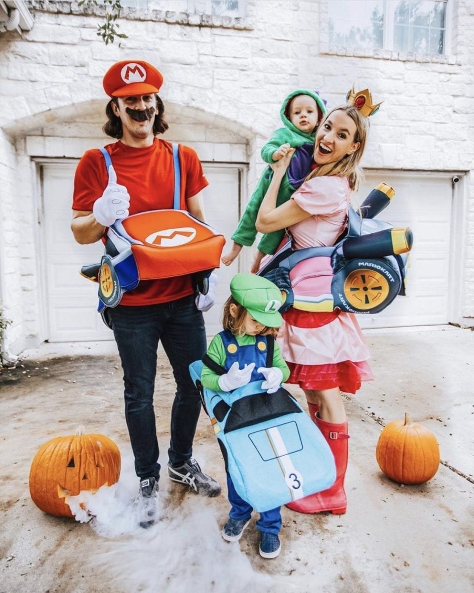 Family dressed up as the characters from Mario Brothers for Halloween.