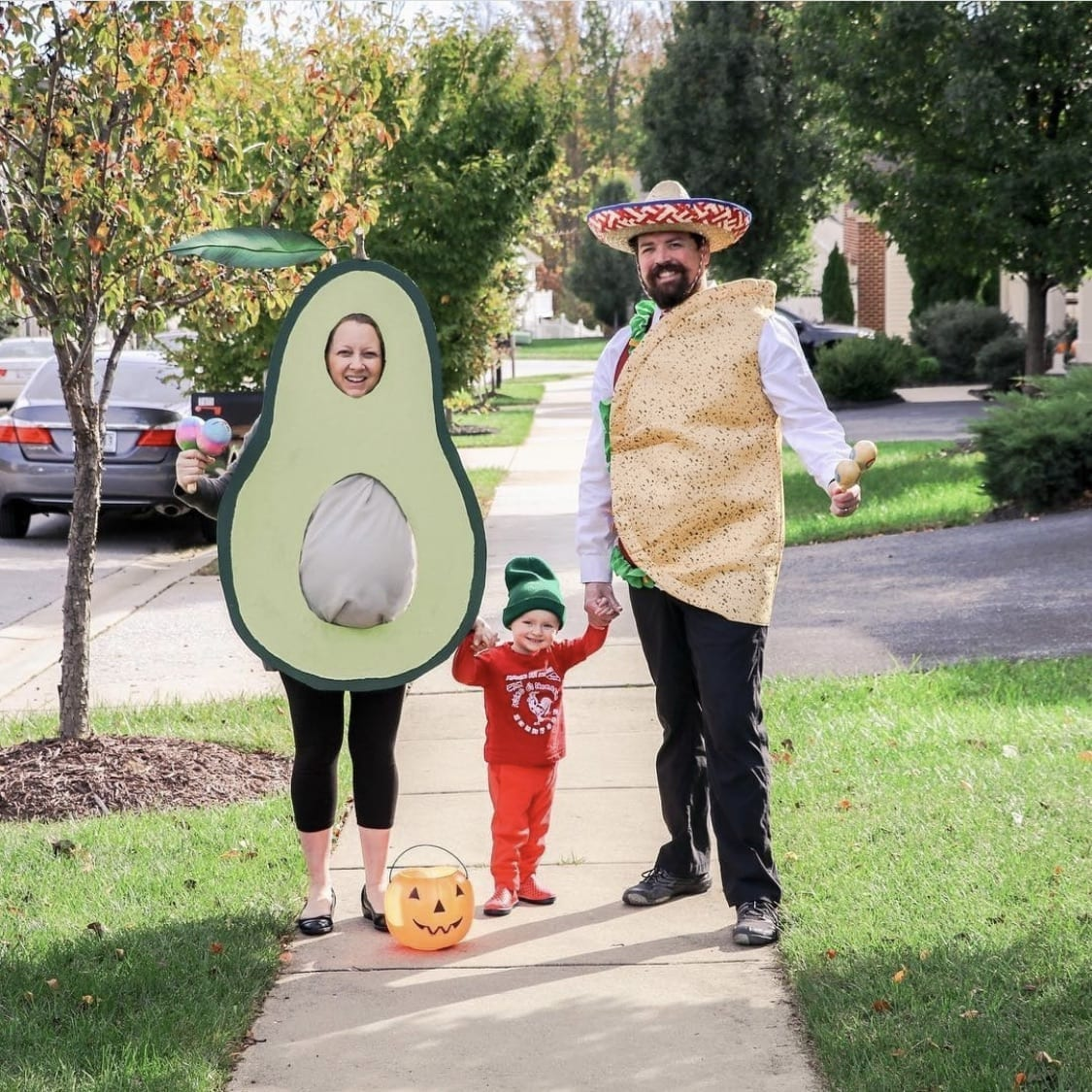 Family dressed up as taco, avocado and hot sauce for Halloween.