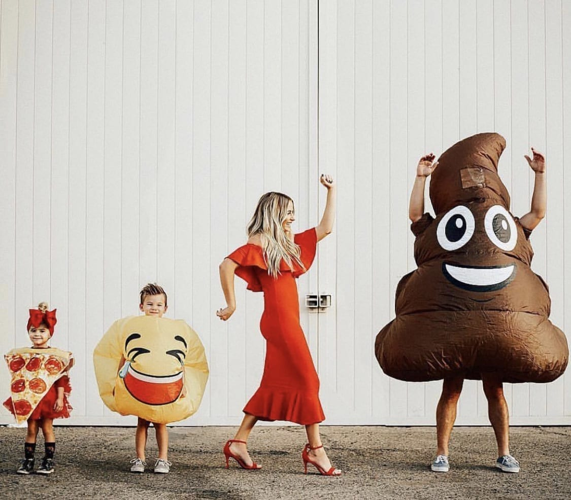 Family dressed up as emojis for Halloween.