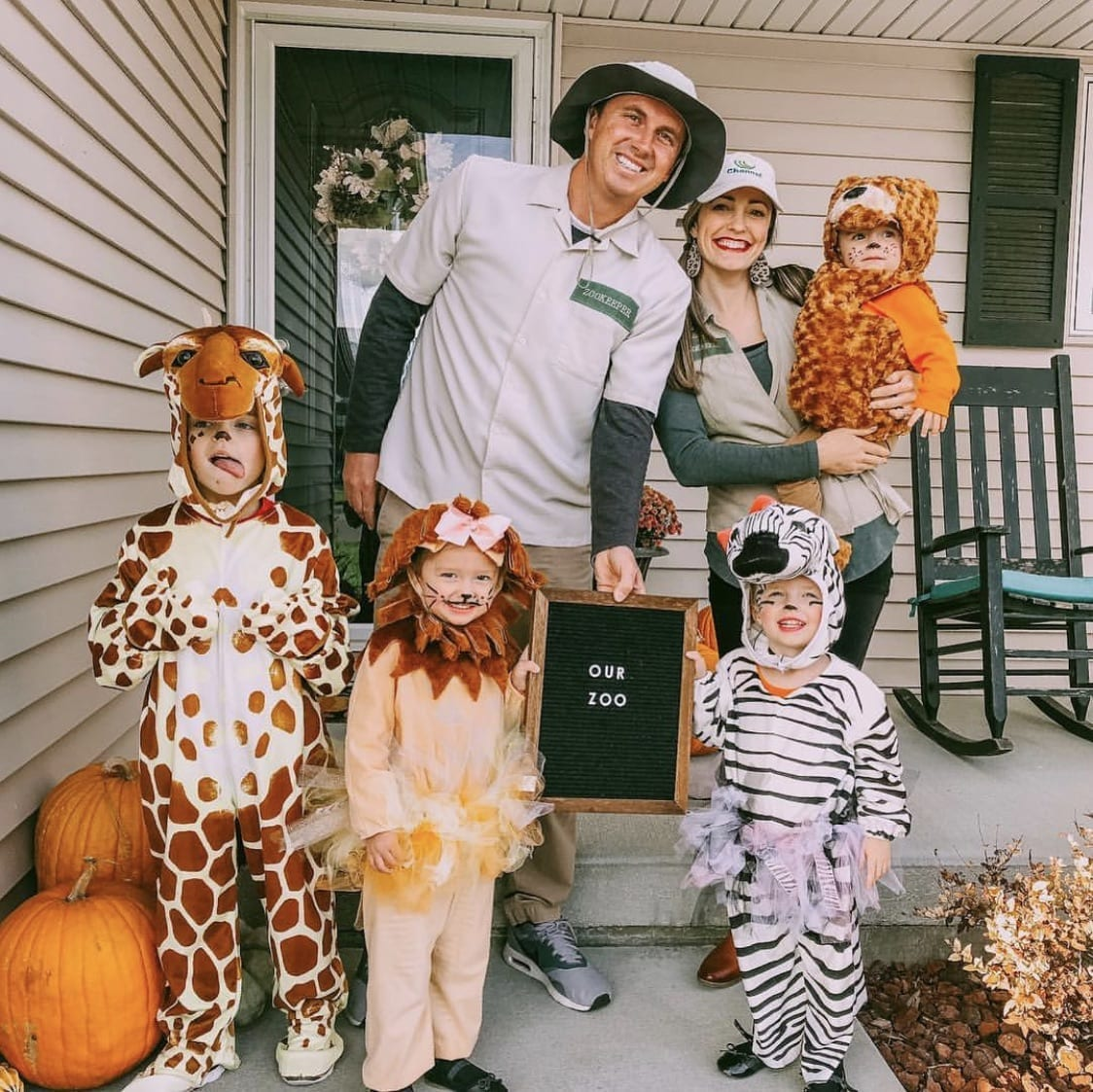 Family dressed up as zoo keepers and animals for Halloween.