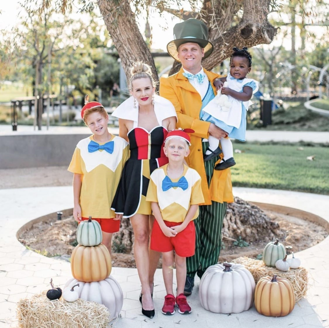 Family dressed up as the characters from Alice in Wonderland for Halloween.