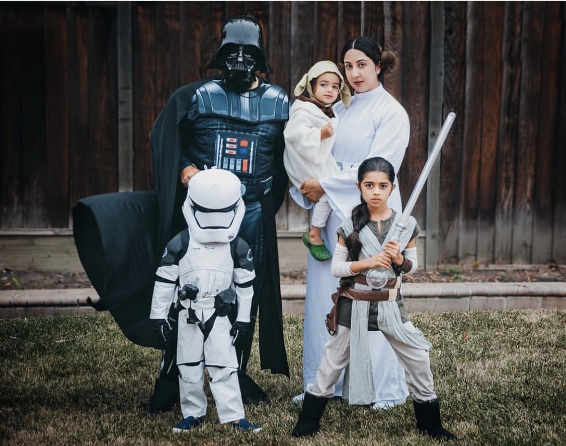 Family dressed up as the characters from Star Wars for Halloween.