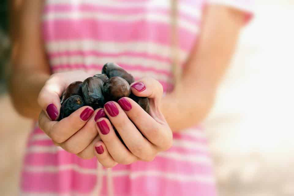 Woman holding a handful of dates.