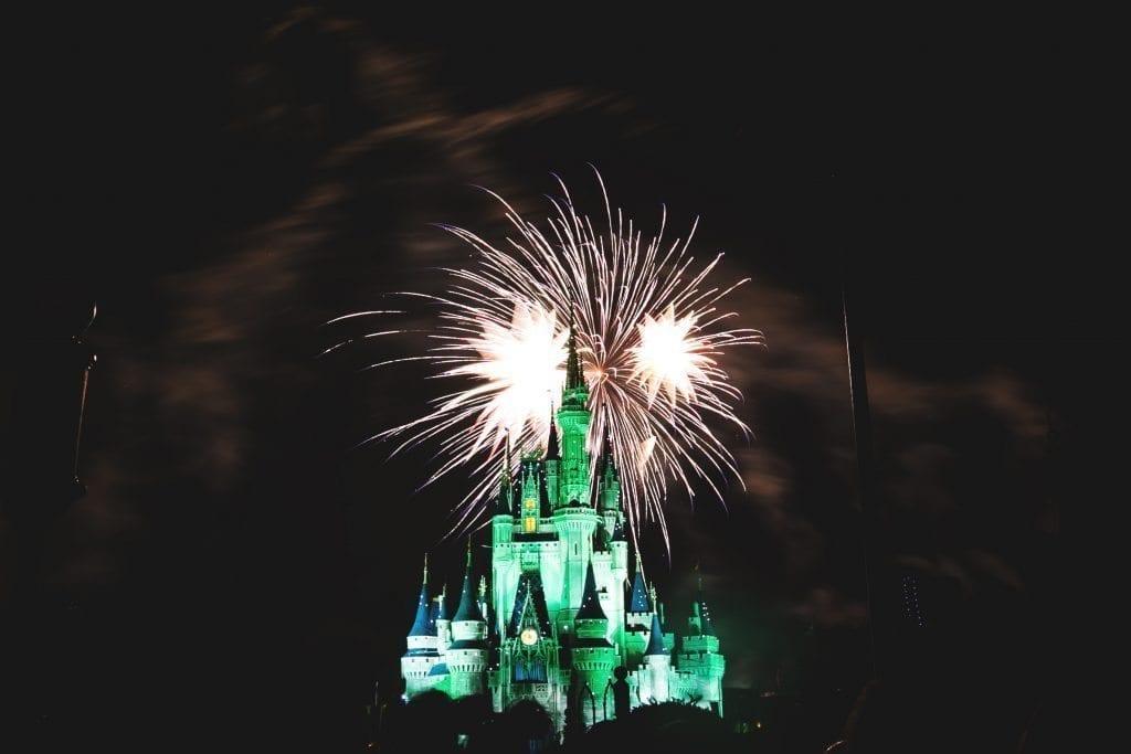 Walt Disney World castle at night with fireworks