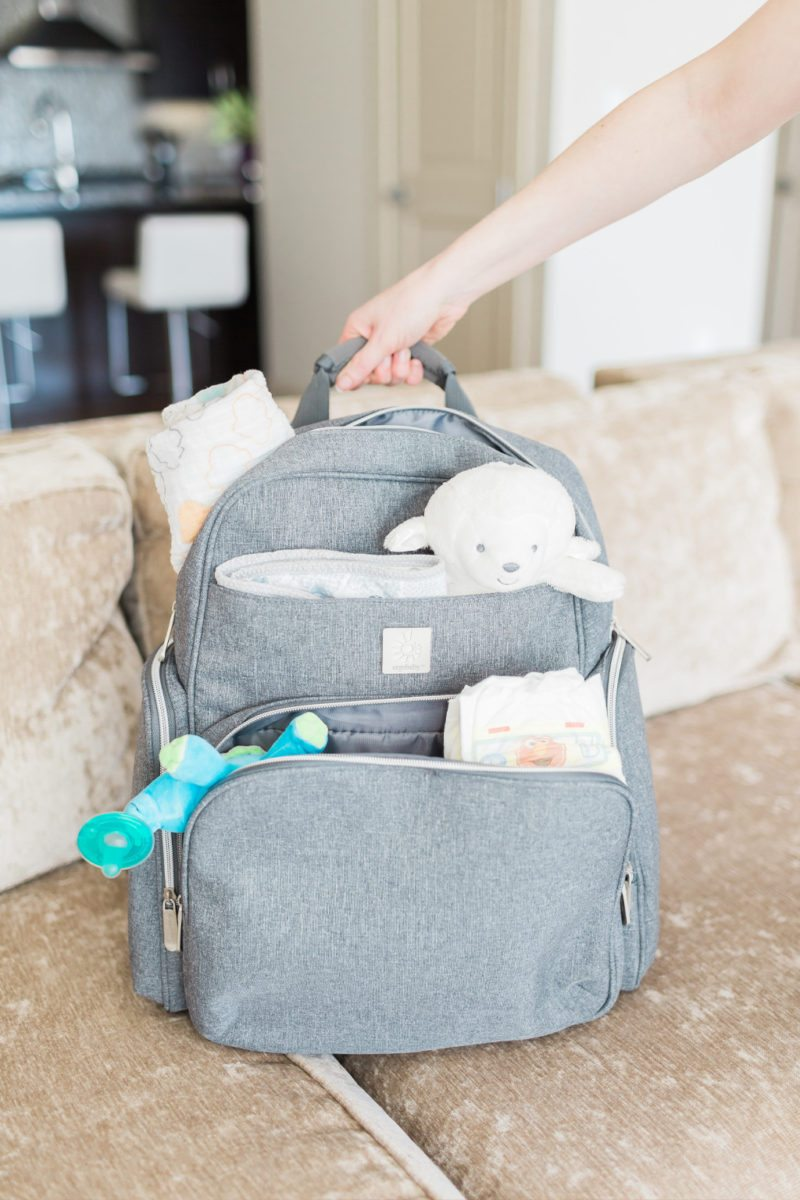 taking care of baby, helping mom out, diaper bag backpack