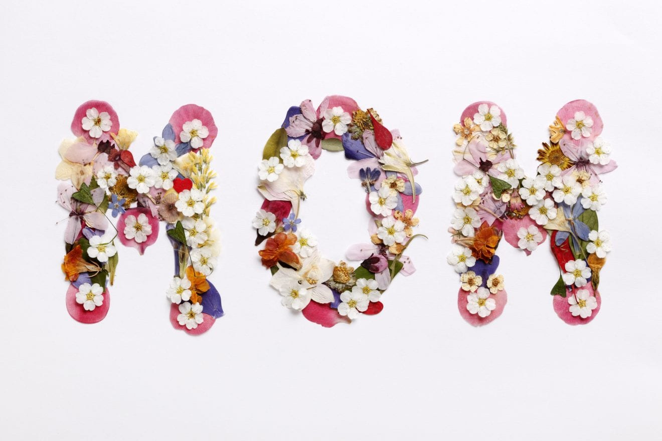 The word mom written with flowers.