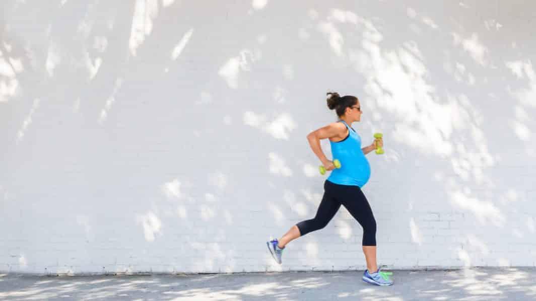 Pregnant woman running.