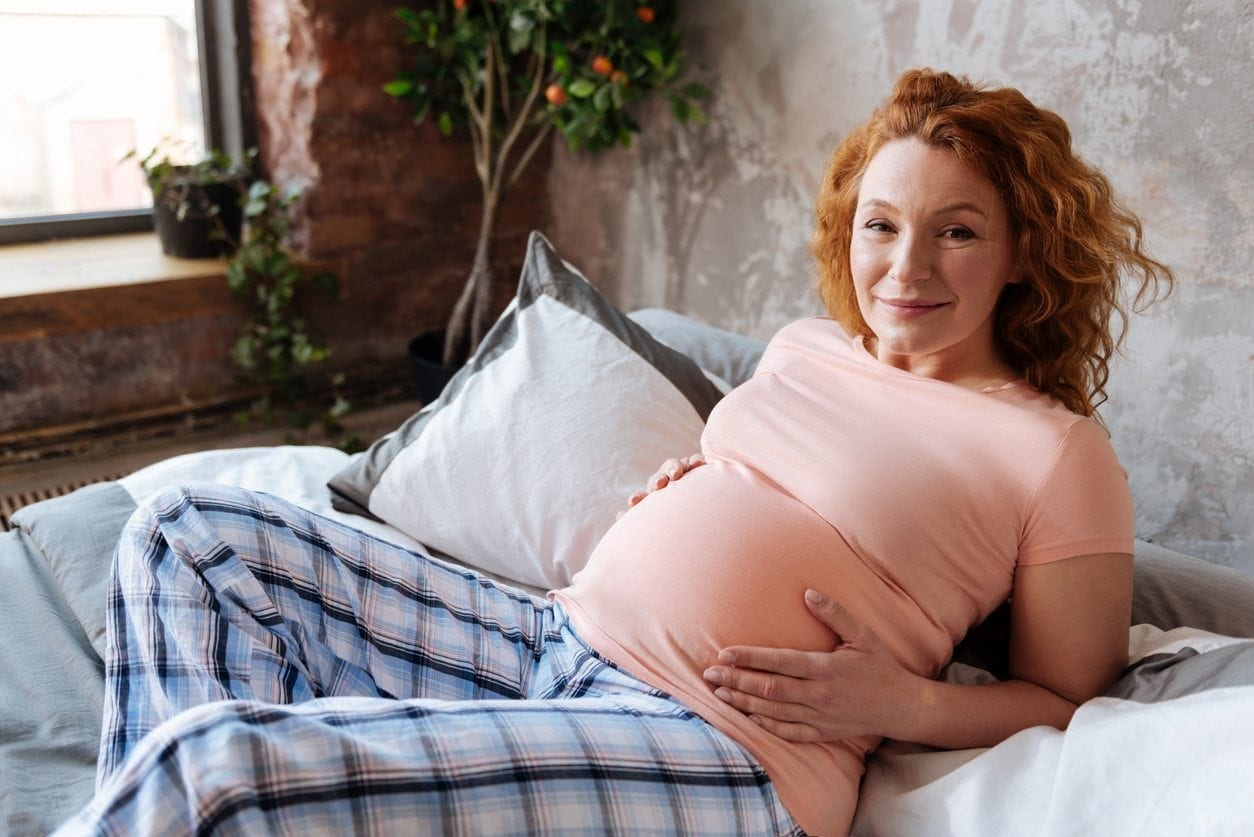 Full-term pregnant woman having rest at home.