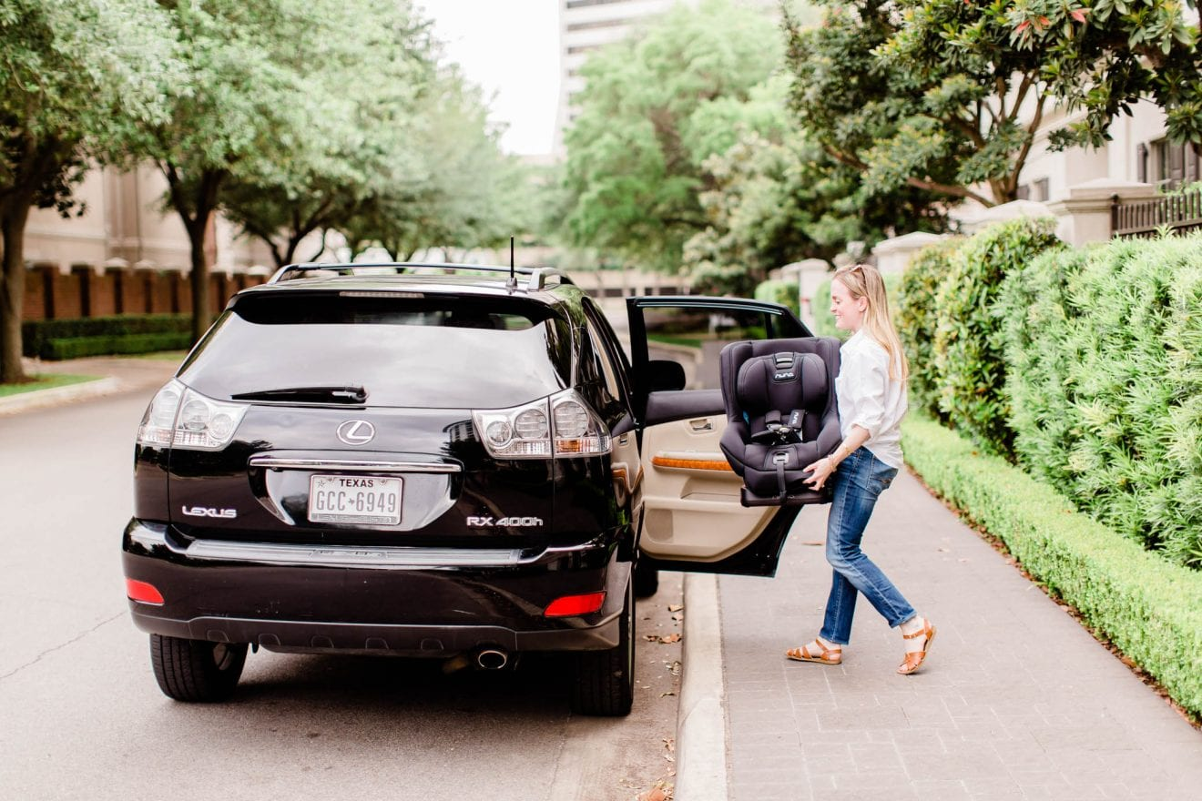 Putting the Nuna Rava convertible car seat in the car.