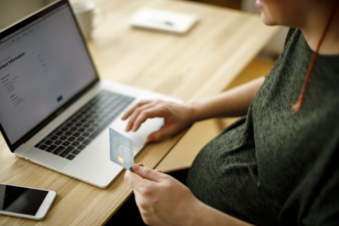 Pregnant woman shopping online on her laptop