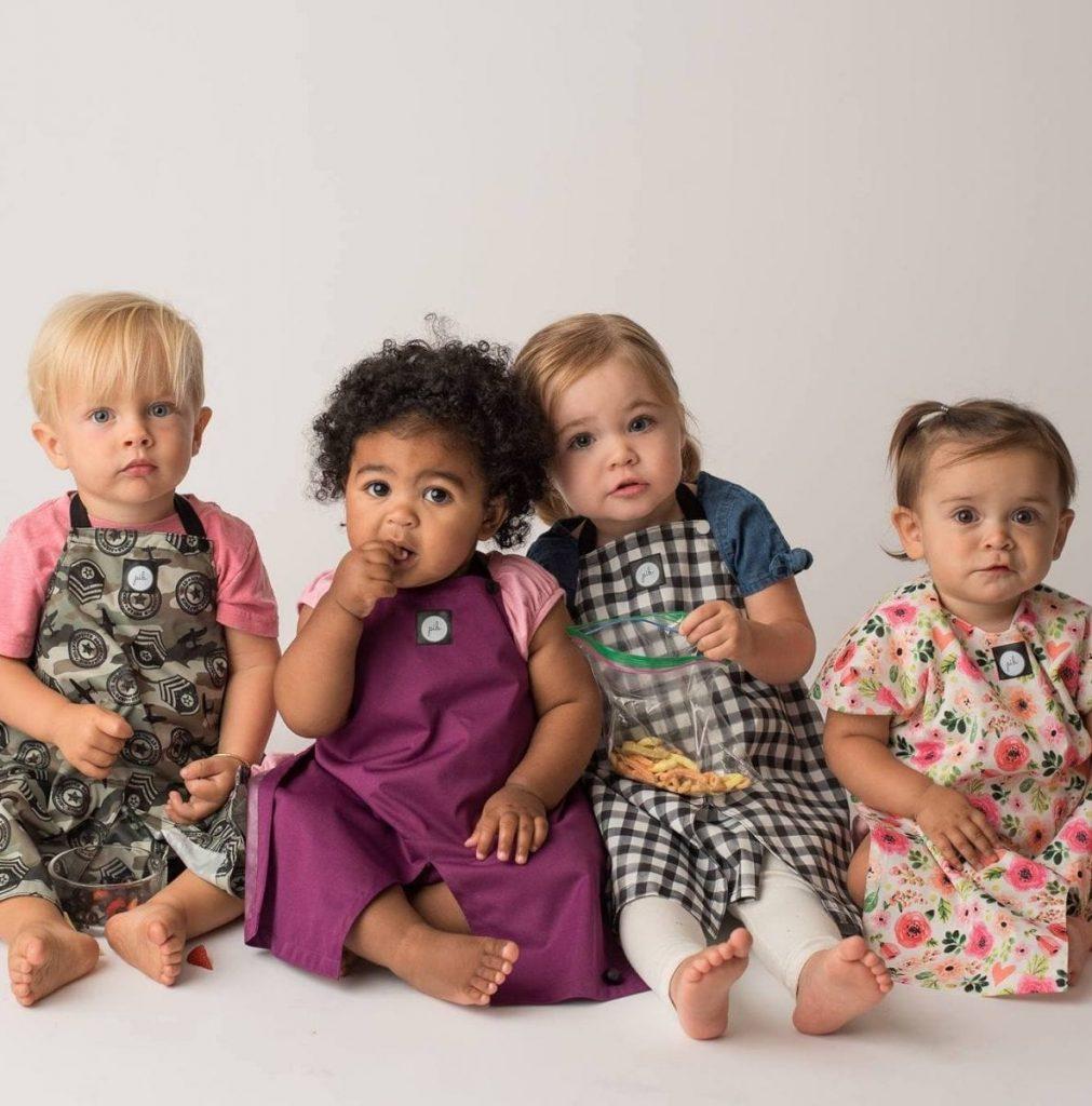 toddler boys and girls wearing pib bibs