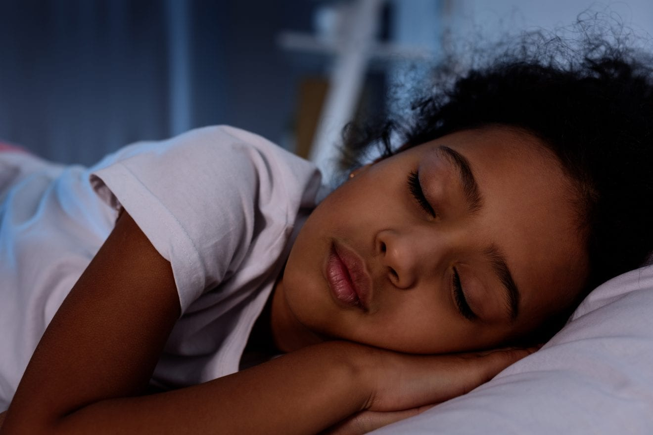 adorable little kid sleeping in bed at home