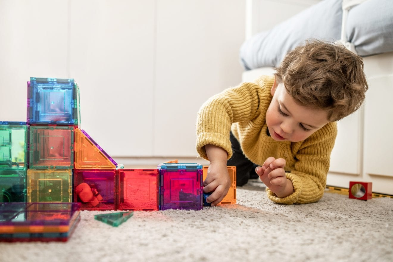Boy playing with building Blocks.