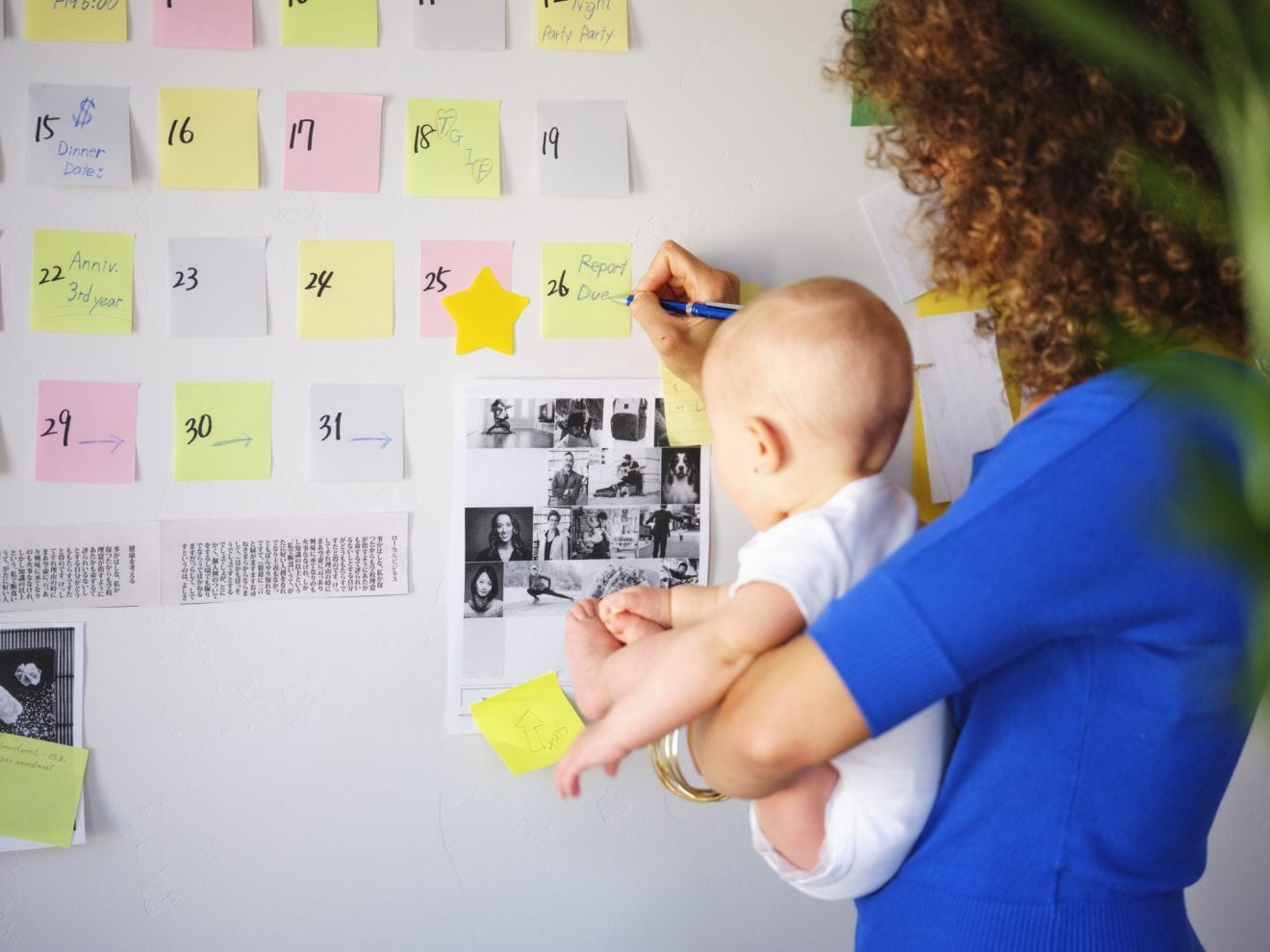 Working Mother Balancing Baby and Design Work