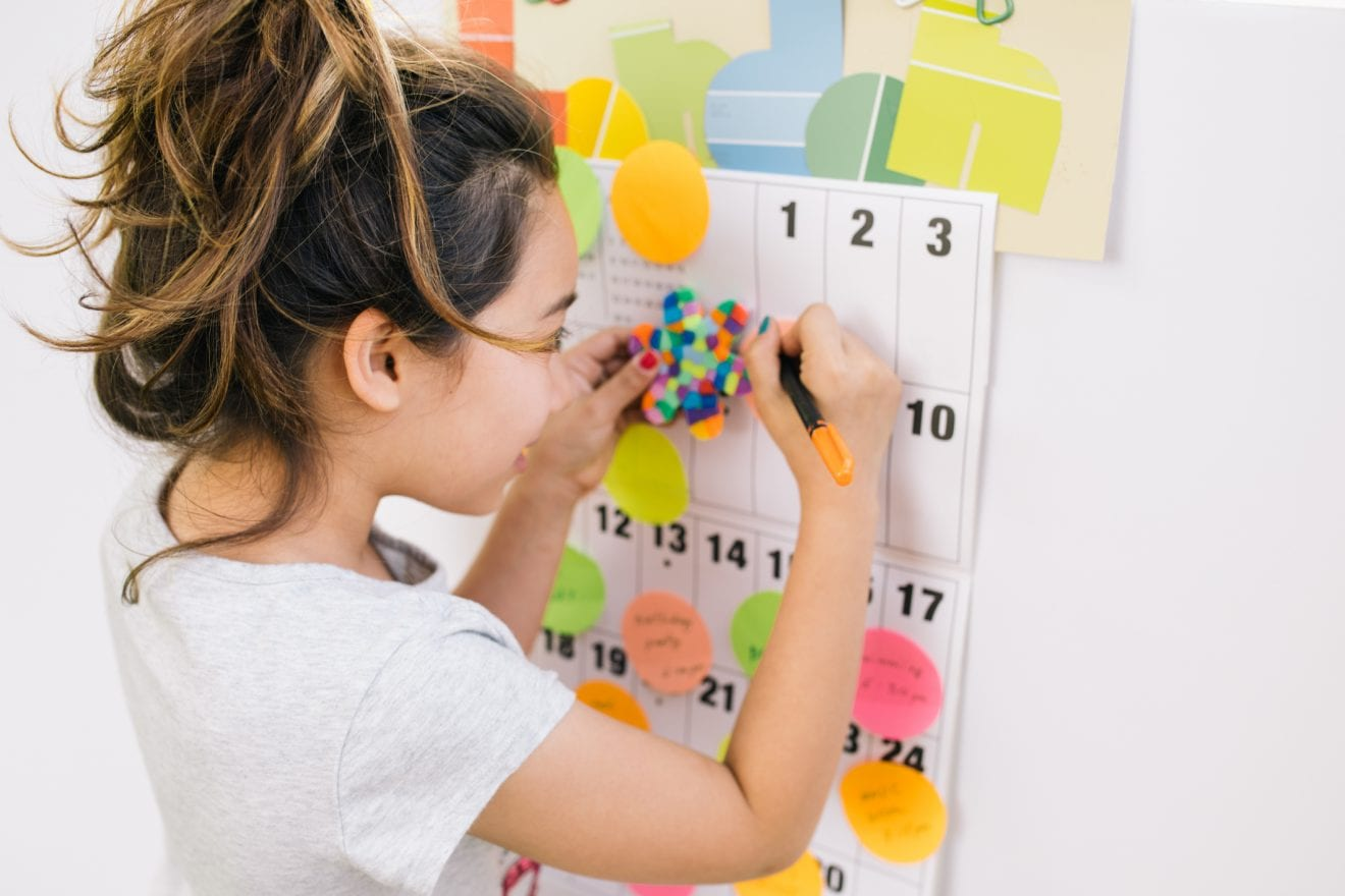 A little girl looking at her schedule