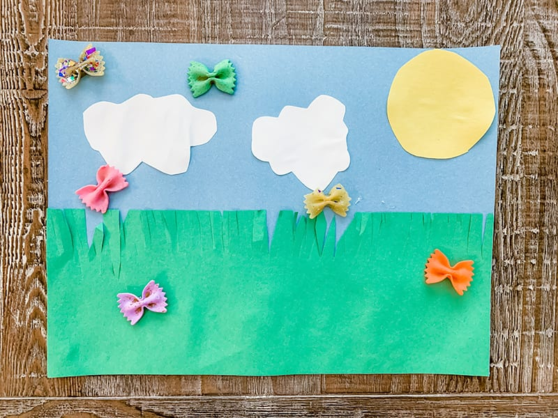 A kid's craft using pasta, paint and construction paper.