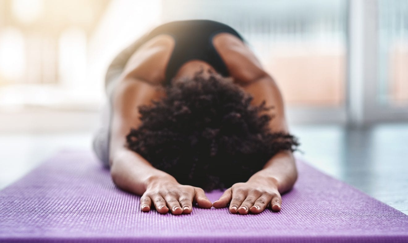 Shot of a beautiful young woman practicing yoga on her mat.