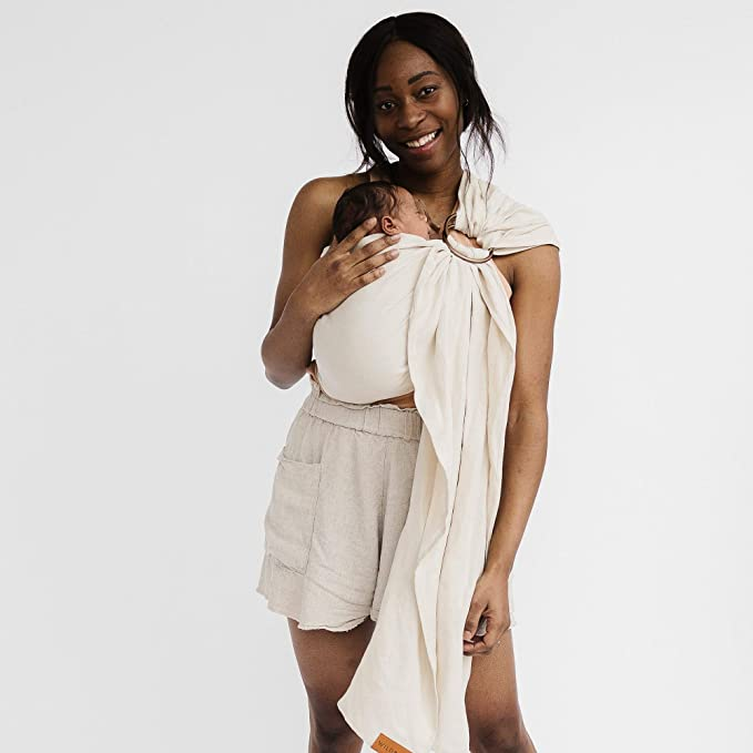 Mother wearing her baby in a Wildbird ring sling.