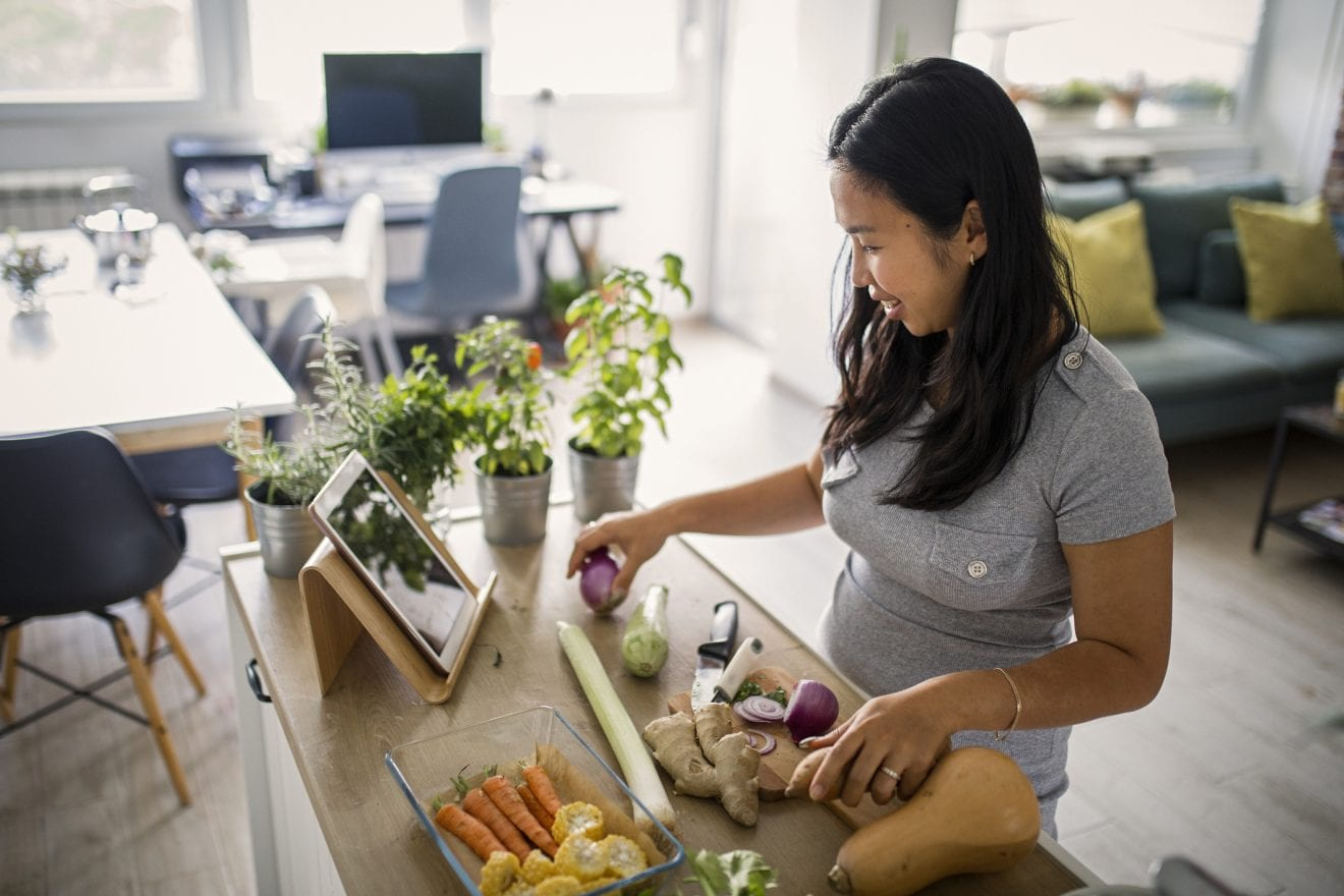 Asian woman at home making a healthy meal