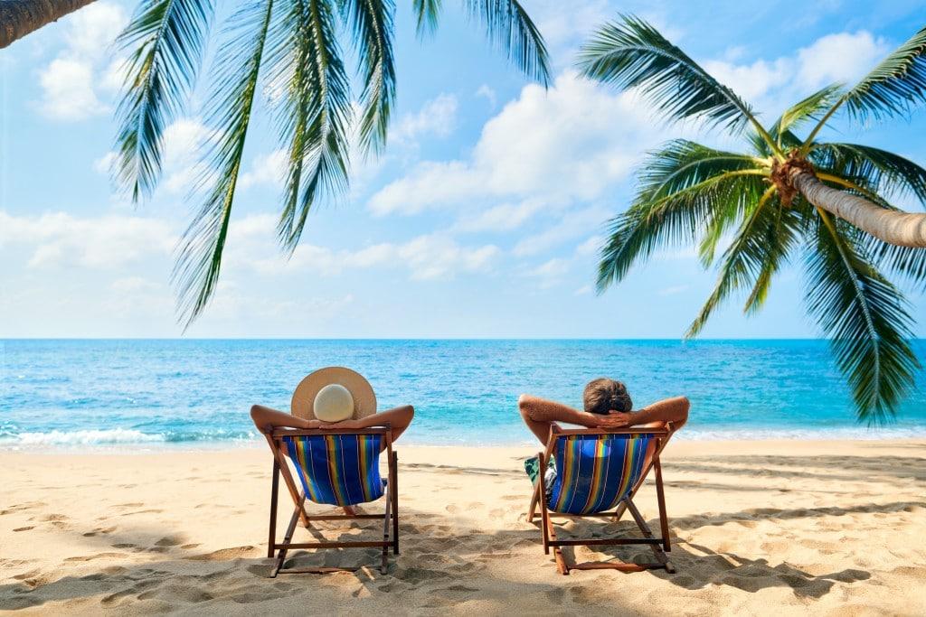 Couple relax on the beach enjoy beautiful sea on the tropical island.
