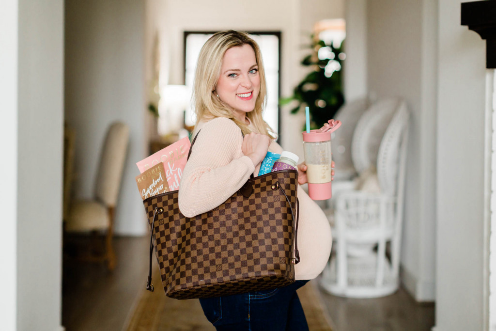 Pregnant mom with her purse filled with Boobie superfoods products.