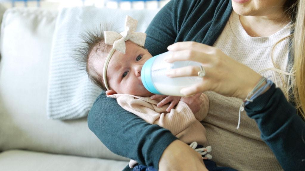 A new mom bottle feeding a newborn