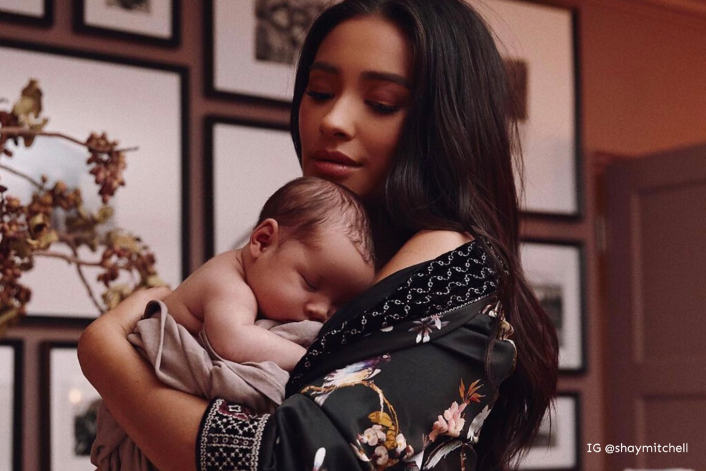 Shay Mitchell holding her baby boy Atlas in his nursery.