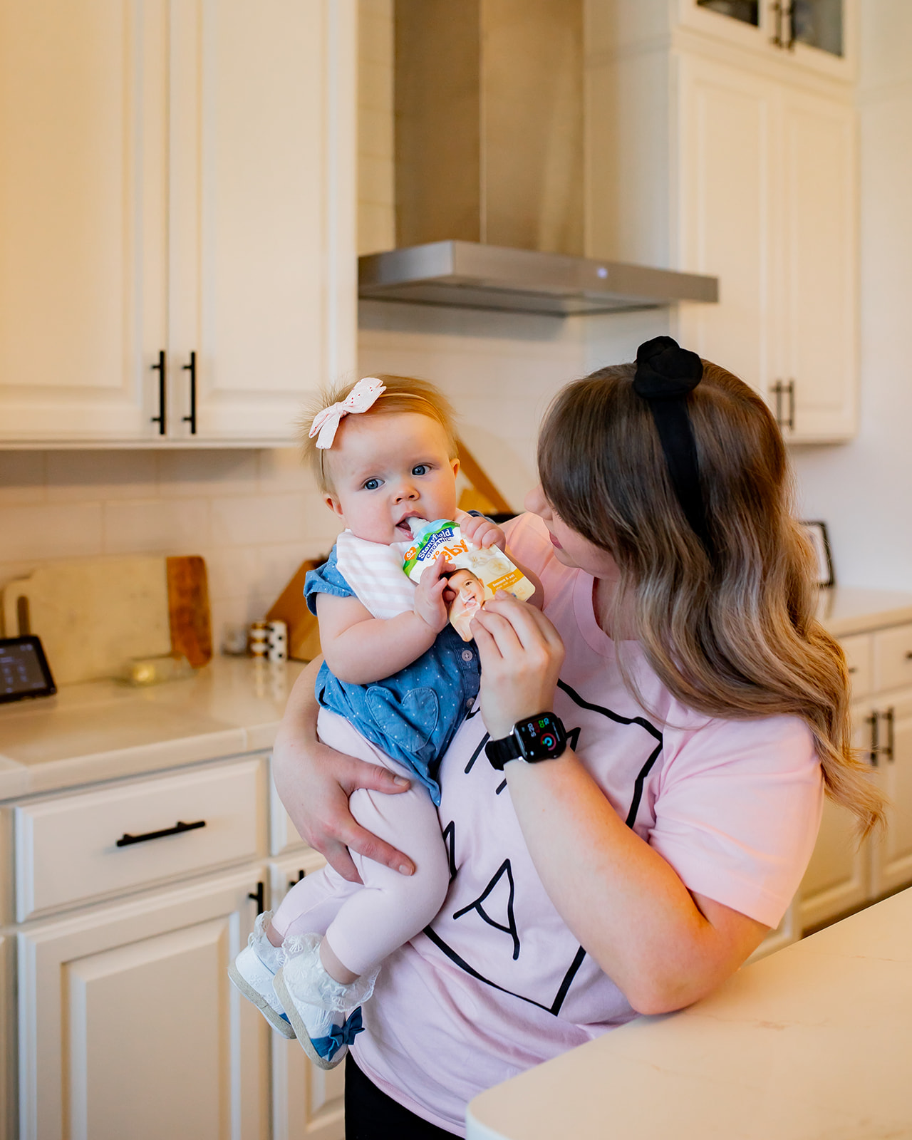 When her daughter ate a Stonyfield yogurt bag, her mother held her baby girl.