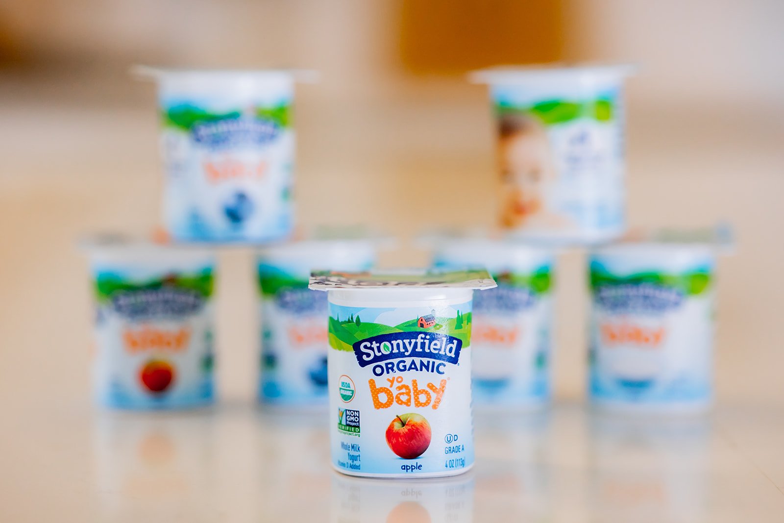 Stonyfield blueberry and apple yogurt cups on the kitchen counter.