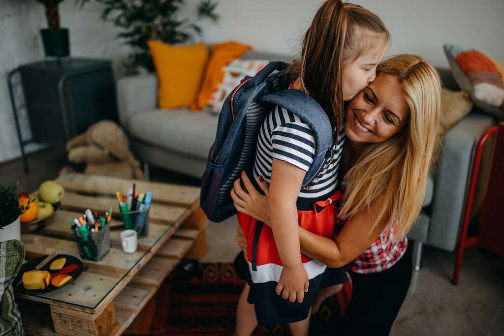 Mother helping daughter with Down's syndrome to stay strong and go to school