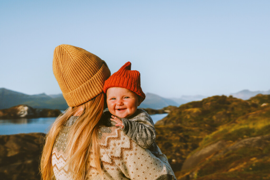 Cute baby and mother walking outdoor travel family vacations lifestyle mom and smiling child together