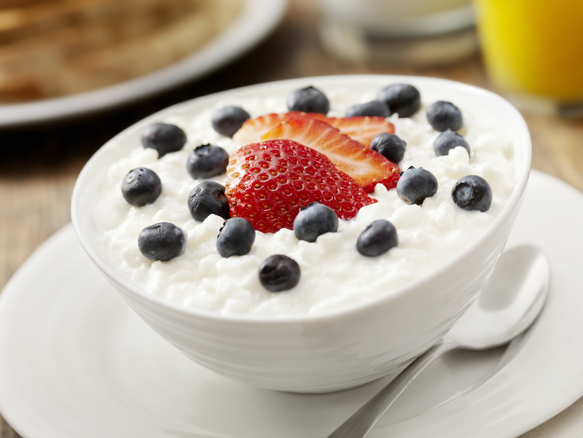 Cheese Cottage with Strawberries and Blueberries, Orange Soup, Milk and Whole Wheat