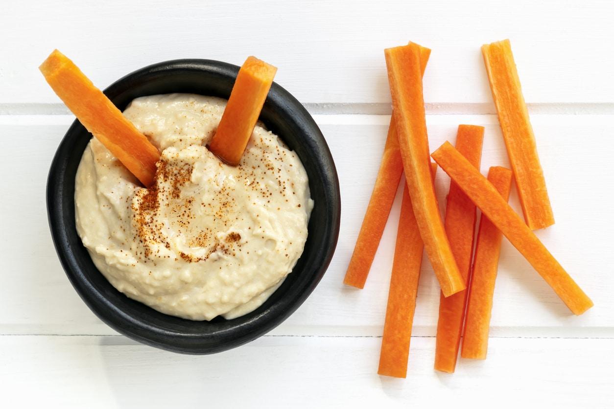 Hummus with carrot sticks.
