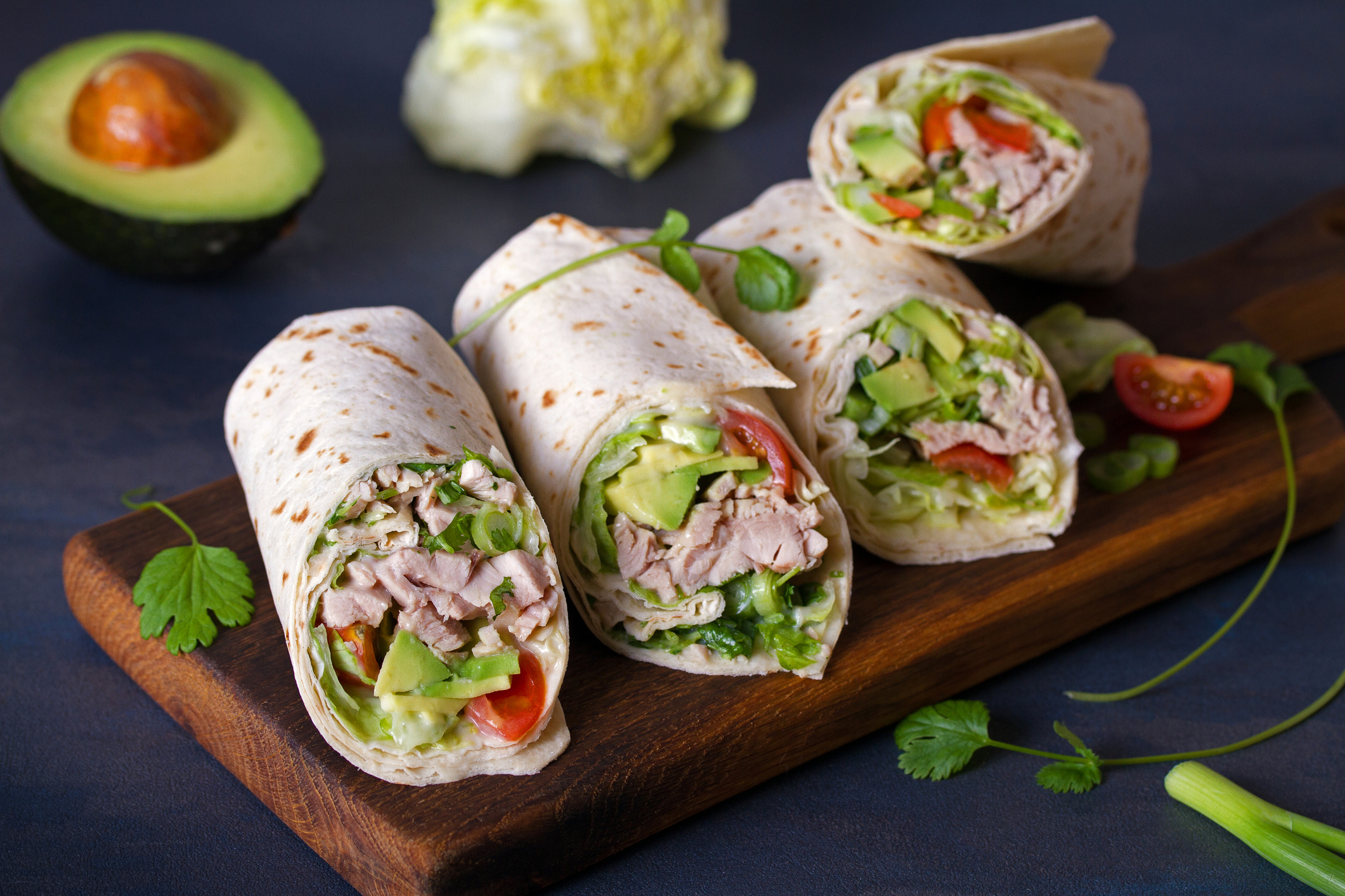 Turkey is wrapped in pear, tomatoes and lettuce when cut.  Tortilla, burritos, sandwiches, twists