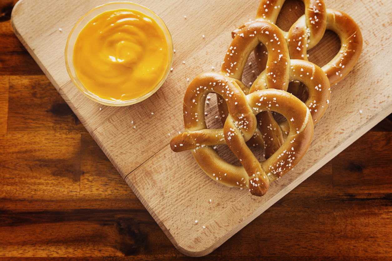pretzels and dip the cheese on top of the cutting boards